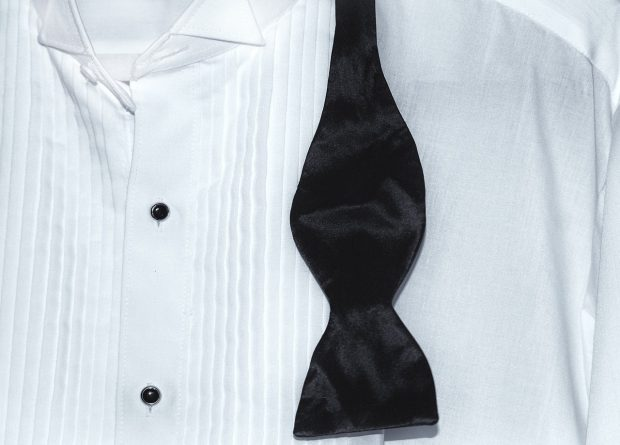 A Guide to Tuxedo Shirts And Styles: Studs on a tuxedo shirt with pleats